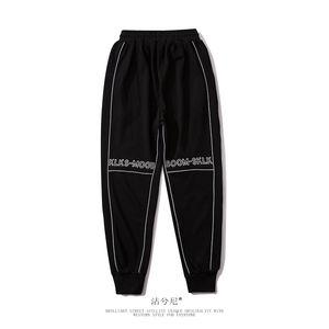 Брюки мужские дизайнерские Светоотражающие ткани Печатные брюки Мужские модные повседневные брюки бесплатно