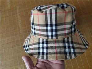 Le nouveau chèque femmes chapeau cloche boutique femmes de la mode mode casual chapeau de mode de la rue commerciale peut être gros