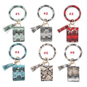 PU-Leder-Troddel-Kreis Schlüsselanhänger Geldbeutel Frauen Wristlet Keychain Mädchen Schlüsselring Geldbeutel Handschlaufe