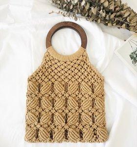 Designer New Lady Handbag Handmade Fishing Net Woven Straw Bag Cotton Rope Net Pocket Beach Lady Bag Fashion Round Wooden Handle Handbags
