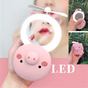 Mini ventilador LED Mango portátil Ventilador de cerdo USB con espejo de maquillaje y luz de relleno para herramientas de viaje familiar Regalos de fiesta XD21355
