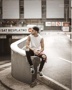 Rasgado de la cremallera del motorista lápiz los pantalones vaqueros de Hiphop Calle Pantalones para hombre del diseñador de agujeros rodilla Jeans Negro rayado blanco