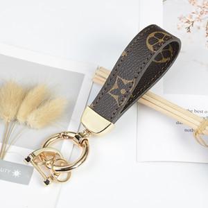 Lujo clave hebilla diseñador de moda llavero marca hecha a mano de la marca de cuero del coche llavero hombre para mujer bolsa estilo colgante accesorios nueva venta caliente