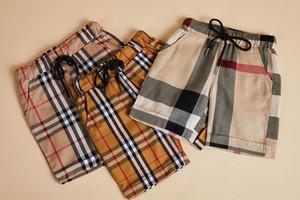 Детские брюки 2019 INS горячие стили Новые летние стили мальчики дети плед брюки высокое качество хлопка повседневные стили шорты 3 цвета бесплатная доставка