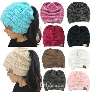 Winter hot sales in Europe and the United States CC labeled hollow top knitting hat hole head warm hat