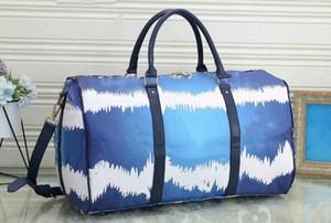 55cm mulheres de grande capacidade sacos venda de qualidade sacos mulheres homens ombro mochilas carregam sobre rebites de fundo bagagem com cabeça bloqueio de viagem
