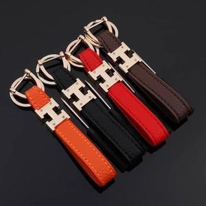 Erkekler Kadın H Harf Tasarımı Anahtar Halkalar Gerçek Deri Anahtarlık Tutucu Araç Keyrings Aksesuarları Moda Çanta Charm Kolye için Marka Anahtarlıklar