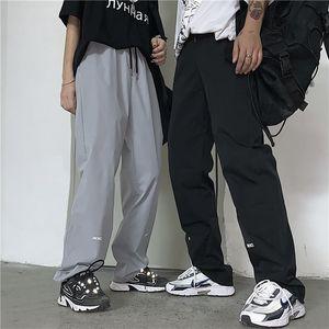 Pantalones de chándal de diseño para mujer y hombre Harajuku Harajuku HOMBRE Piernas recreativas Pantalones rectos Estampado de letras Pantalón suelto con parte inferior de Baitao
