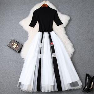 Europea y americana de ropa de mujer 2019 verano nuevo estilo manga corta negro de punto camiseta de malla traje de falda de cuentas