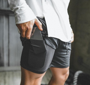 2019 New Men Sport Gym Compression-Telefon-Tasche Tragen Sie unter Base Layer Short Pants Sportlich feste Strumpfhosen Shorts Hosen