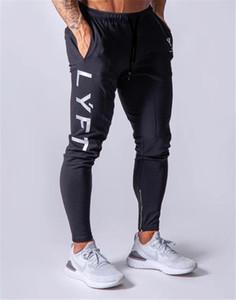 Nuevos pantalones de Jogging para hombre, pantalones deportivos para correr, pantalones de gimnasio, pantalones de chándal de algodón, pantalones ajustados para culturismo