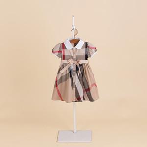 Nueva pista de algodón a cuadros falda de las muchachas del bebé solapas clásicas Vestido corto princesa de manga de los niños se visten La falda