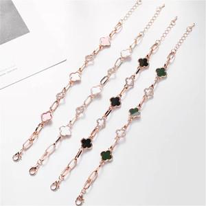 Hohle Vier Kleeblatt Modische Designer Luxus-Armband-Armbänder für Frauen Zirkon Strass Intarsien Schwarz Weiß Grün und Rosa