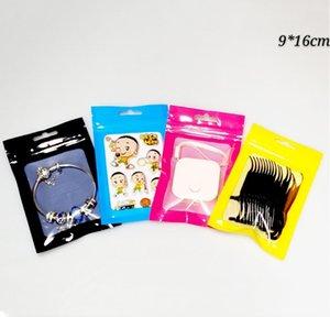 9 * 16cm 100pcs Sacs d'emballage en alumineuse colorées de couleur colorée RESEALABLE CLAIR sur le sac en plastique MyLar avant pour les haricots et les graines avec trou de suspension