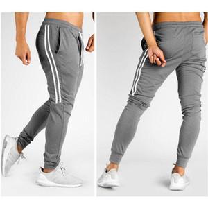 Конструктор Мужская Hip Hop Sweatpants Фитнес Joggers Spring Мужской Side нашивки High Street Hip Длинные брюки шаровары Sweatpant