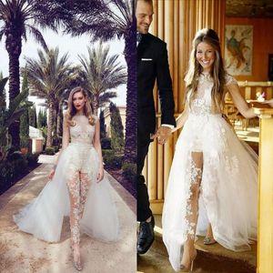 Иллюзия Комбинезоны Свадебные платья с Съемные Поезд Кружева Аппликации Cap рукава тюль Overskirt с карманом платье Свадебные
