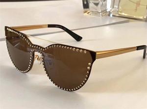 Diseñador de lujo Marca Medusa Gafas de sol Ojo de gato Sin montura Para mujer Gafas de moda anti-UV400 Lente Atmósfera simple Estilo Gafas con estuche