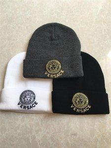 Las mejores marcas Beanie mujeres y el hombre del sombrero de Skully de moda caliente grueso del estiramiento suave del tejido en cable holgados Beanie Sombreros de invierno de esquí Cap 5564