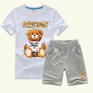 Crianças Estilo Hot clássico Novo Suit Vestuário para meninos 2-7 anos e meninas Sports Baby Boy Infant Designer manga curta Roupas Crianças Set