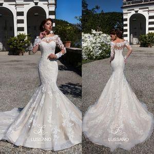 2020 Vintage Meerjungfrau Spitze Brautkleider Bloße lange Ärmel Appliqued Schaufel-Ausschnitt langer Zug-Land Nigerian Brautkleider