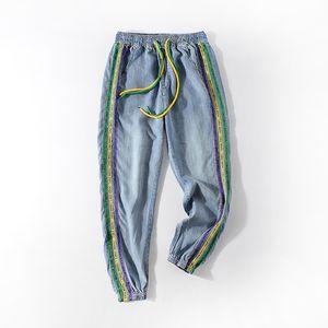 Pantalones vaqueros de las mujeres de cintura alta nueve puntos Harem 2020 Verano Nueva Harajuku cintura elástico de la manera ocasional pantalones de Jean YUPINCIAGA