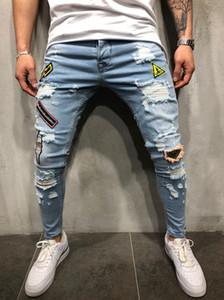 Wholesale Fashion men s hole hole elastic hollow tight riding jeans badge embroidered label to destroy the slim body leg jeans