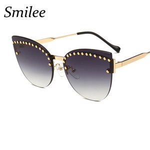 Wholesale Gradient blue Gray Sunglasses Chic Cat Eye Shades Women Designer High Fashion New Frameless Sunglasses Female Metal Pearl