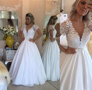 Wholesale 2019 White Saudi Arabic Wedding Dresses Vintage V neck Short Sleeves Lace Pearls Sheer Bodice A line Bridal Ball Gown with Belt