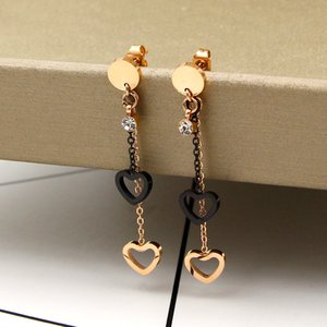2019 new fashion stone bracket between black tassel double heart rose gold stud fashionable titanium steel plated color gold stud
