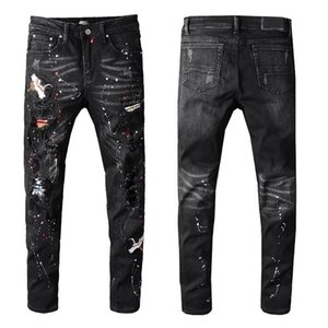 Amiri Mens jeans Rock Revival Hole Denim Trousers Embroidery Painted Straight pants Fashion Trend Motorcycle pants Casual Wild Hip hop pants