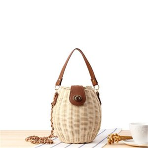 Factory wholesale women handbag fashion woven bucket bag new Japanese small fish basket lock handbag small fresh rattan woven chain bag