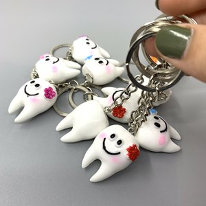 Wholesale Cute imitation resin tooth key chain creative couple key chain dental dental mobile phone bag pendant tooth shape small gift