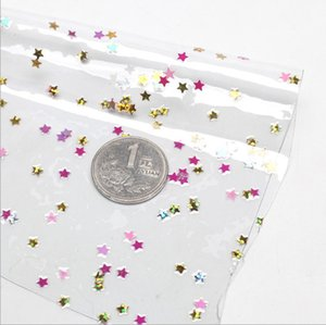 Iridescent flowers and stars crystal clear PVC film fabric transparent bag plastic bow process 7 color