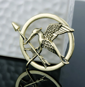 Wholesale 3 Colors The Hunger Games Brooches Inspired Mockingjay And Arrow Movie Hunger Games Bird Brooch Pins Children Best Gift L582