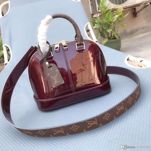 Fashionable new lady's hand-painted shell bag designer package wine red, black, pink, peach, light pink number: M54785.