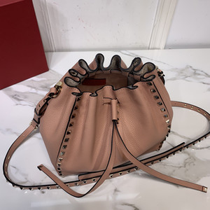 Wholesale drawing string bags resale online - The new series Grain leather shoulder bag Vacuum plated rivets and metal hardware Opening and closing of draw string fashion bags