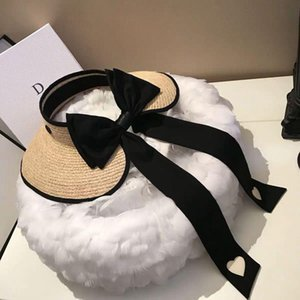 playa en topless al por mayor-Hierba con topless sombrero de mujer verano plegable sombrero de paja sombrero de paja Big Brim Bow Ribbon Beach Fashion