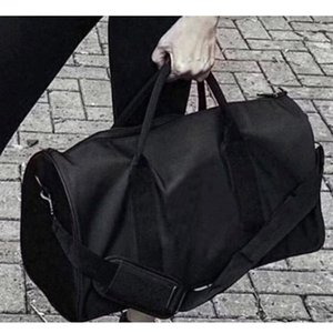 Wholesale designer brand travel bags resale online - Black Brand Durable Stylish Sports Bag Outdoor Gym Yoga Exercise Travel Bags Folding Luggage Duffle Home Storage Organization HH21