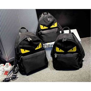 Wholesale schoolbag yellow for sale - Group buy Authentic fashion waterproof nylon cloth little monster backpack yellow eyes schoolbag all purpose backpack for boys and girls