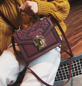 Factory wholesale brand handbag new leather handbag Korean retro hollow carved portable single shoulder bag handbag lock fashion brand on Sale