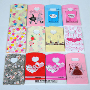 100pcs lot cartoon plastic packing bags heart cute jewelry gift bag clothes Pouches small middle large size packing bag