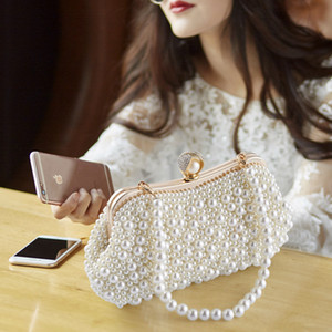 Wholesale Fashion hand pure boutique wedding bride pearl handbag dinner dress dress bag oblique cross package