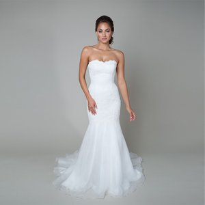Trumpet Style Wedding Gown Features a Dropped Waist a Sweetheart Neckline a Flowing Organza Skirt And Corded Lace Bridal Dress