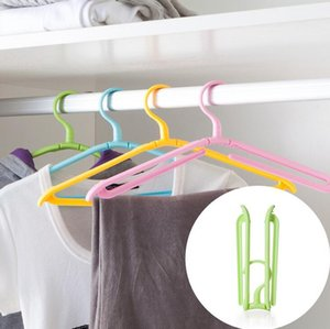 Wholesale new household helper travel camping portable foldable plastic magic hanger rotating non slip drying racks for laundry clothes storage