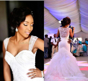 Sexy African White Sweetheart Mermaid Wedding Dresses 2018 Court Train Sheer Back Applique Beaded Pearls Bridal Gown robe de mariage