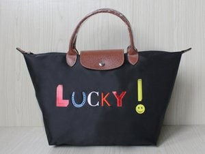 Wholesale New fashion color women new satchel waterproof nylon Oxford leisure trend big size shopping shoulder bag lucky smile desinger leather handle