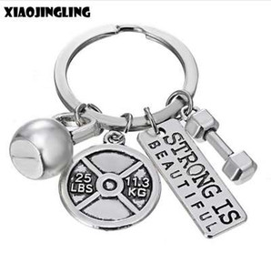 Wholesale XIAOJINGLIG Personalized Barbell Dumbbell Keychain STRONG IS BEAUTIFUL Key Chain Men s Charm Women s Gym Sport Fashion Key Ring