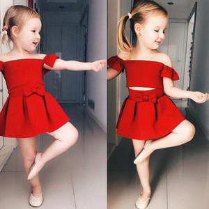 Wholesale INS Hot Baby Girls Clothes Set Cute Red Boat Neck Off Shoulder Fluffy T shitrs Bow Pleated Skirt Two Piece Set Performance Costume