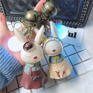 Wholesale Creative light bulb rabbit key ring cute doll car key chain personalized jewelry pendant