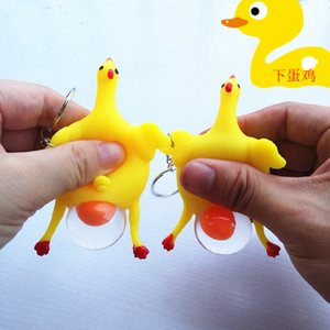 Wholesale Anti Stress Face Reliever Autism Healthy Toy Baby Funny Creative Toy Layer Chicken Trick with Key Chain New Year Costume